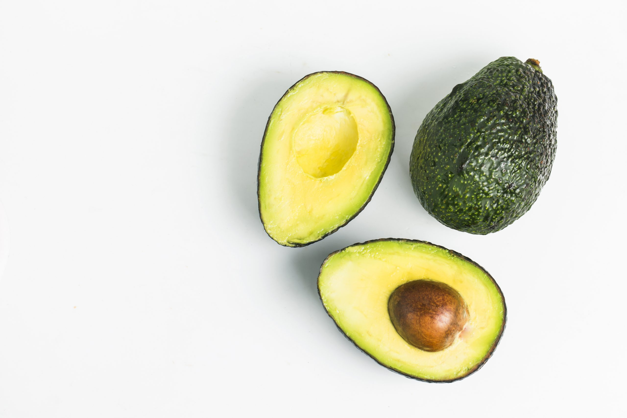 avocado dark wood background scaled