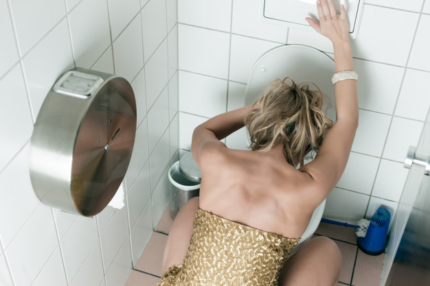 woman throwing up toilet 79405 8571